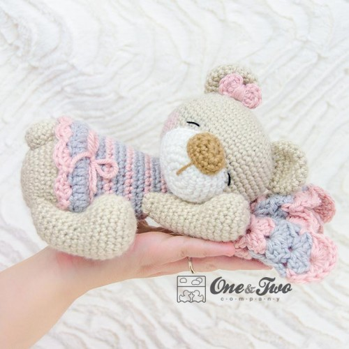 A Small Knitted Teddy Bear In A Wicker Basket. A Sleepy Bear Cub ... | 500x500